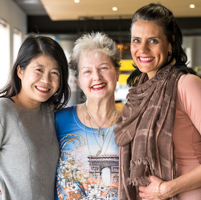 Three women of different ages and ethnic backgrounds