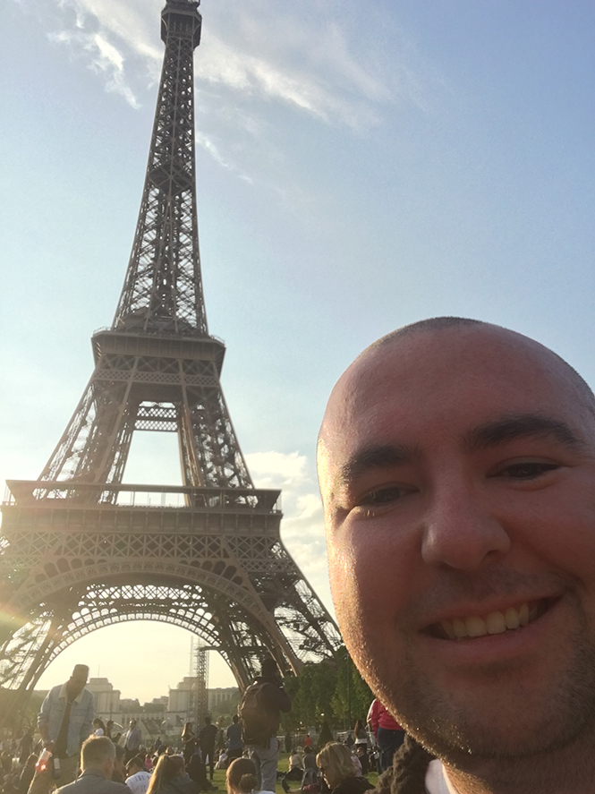 Trent in front of the Eiffel Tower during his celebratory Europe trip.