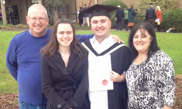 Trent with his mum, dad and sister at his graduation in 2015.