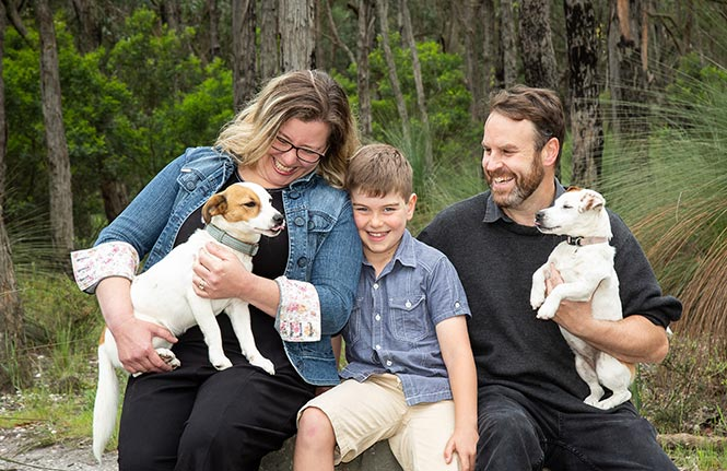 Emma with her son Gus, husband Ben and their two dogs.