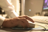 A hand using a computer mouse