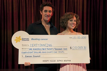 Dirty Dancing performers with cheque